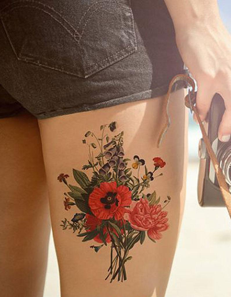 tatouage cuisse fleur - 15 tatouages sur la cuisse qui nous font de