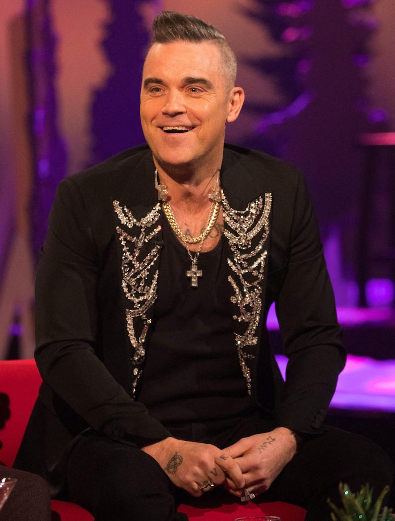 Les émouvantes retrouvailles de Robbie Williams avec ses enfants après 3 semaines de quarantaine - Elle
